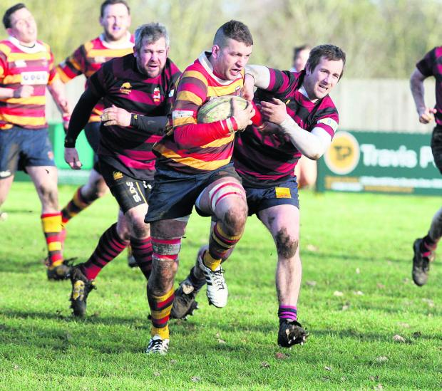Bicester Advertiser: Bicester skipper Dan Spencer, who scored two of his side's tries in the 29-19 home win against Hungerford, goes on a lung-bursting break