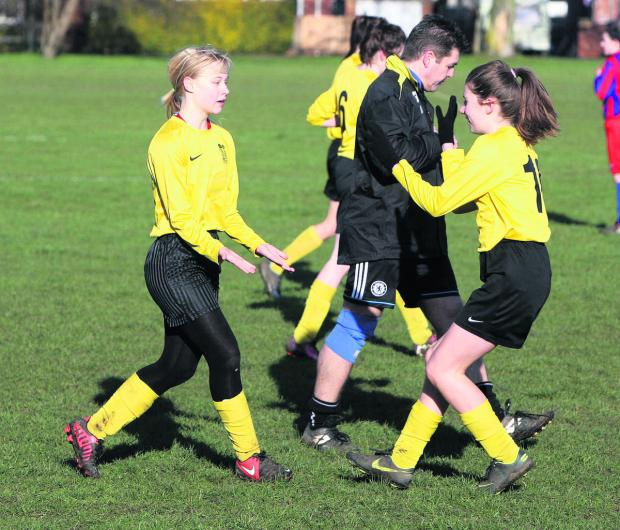 Bicester Advertiser: Benson's Alana Jones celebrates her first goal against Tower Hill with teammate Freya Wilcock