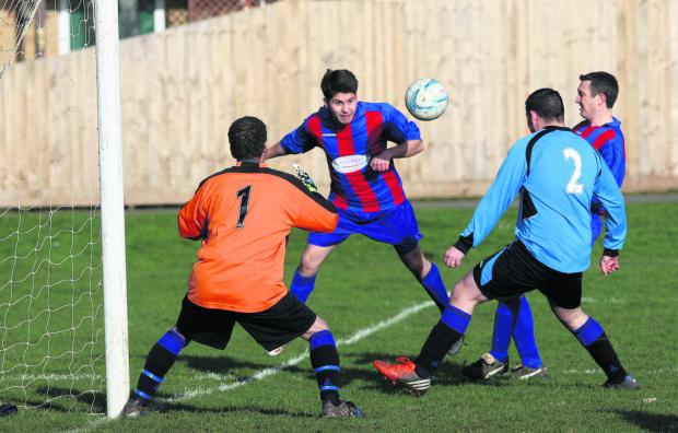 Woodstock's Nathan Lawes puts pressure on Village Inn keeper Colin Fell