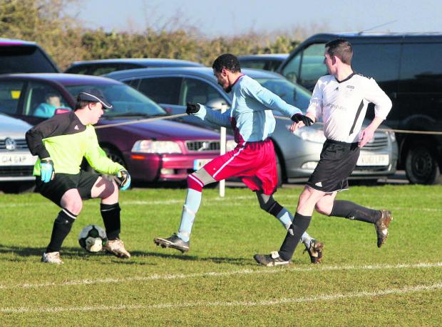 Bletchingdon's Jordan Grey is denied by  keeper Dave Beehan in the 3-0 home win