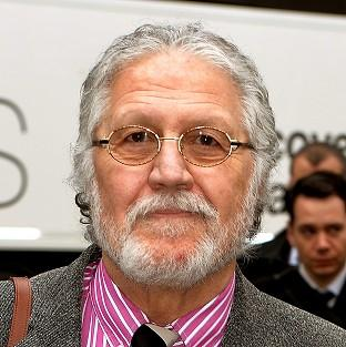 DJ Dave Lee Travis arrives at Southwark Crown Court in London, where he is accused of 13 counts of indecent assault and one count of sexua