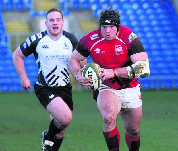 Bicester Advertiser: London Welsh prop James Tideswell powers through for their third try against Rotherham
