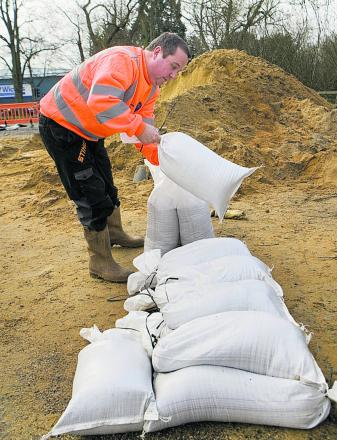 Filling sandbags at Seacourt Park-and-Ride