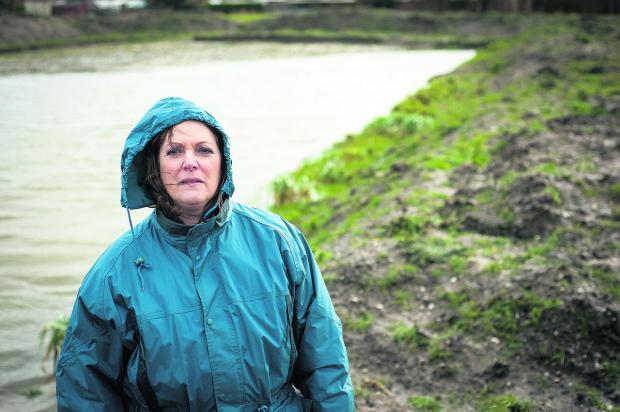 Bicester Advertiser: Zoe Patrick at the flooded field in Grove 	Picture: OX65273 Andrew Walmsley