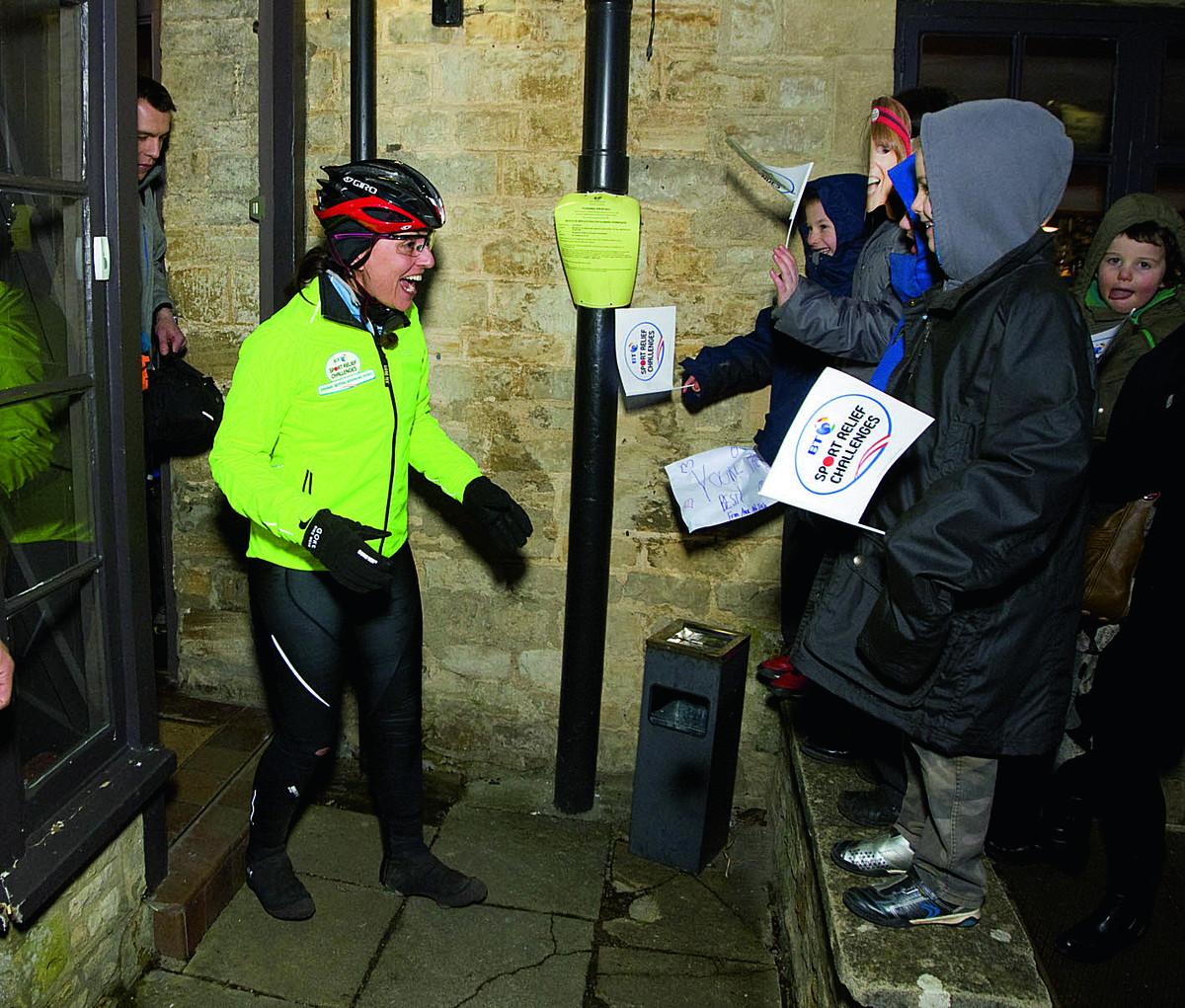 Davina McCall is greeted by cheering children at Killingworth Castle, Wootton, after she arrived for a stop during her Sport Relief challeng