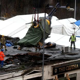 Bicester Advertiser: The wreckage of the police Eurocopter is lifted from the Clutha Vaults in Glasgow following the crash