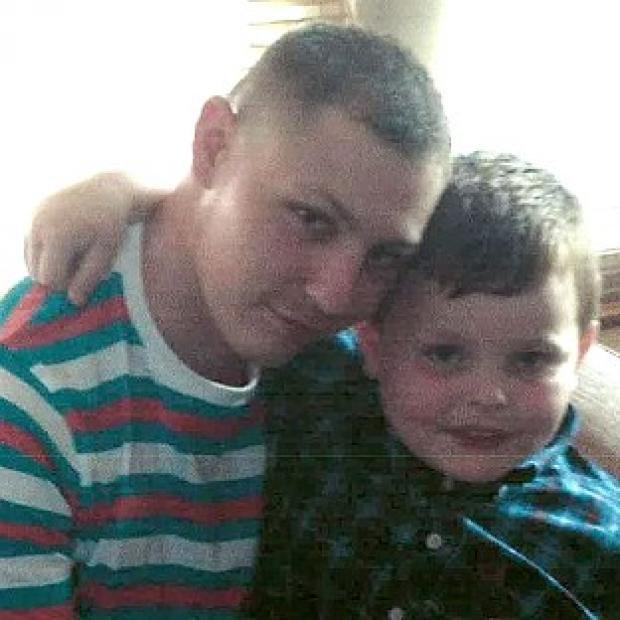 Bicester Advertiser: Dean Mayley, seen here hugging his seven-year-old nephew Callum, was stabbed in the heart as he walked along a west London street on February 7 (Metropolitan Police/PA)