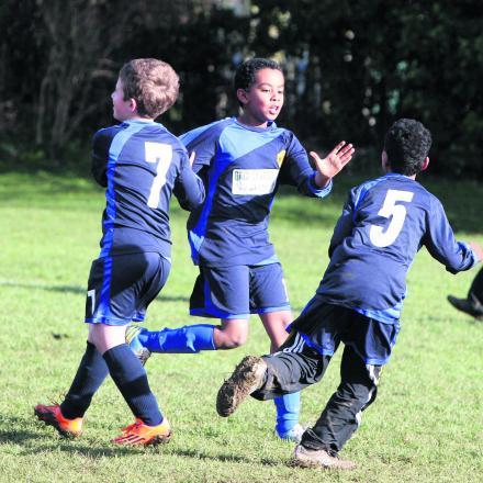 East Oxford's Mohammed Hassan shows delight after netting against Summertown