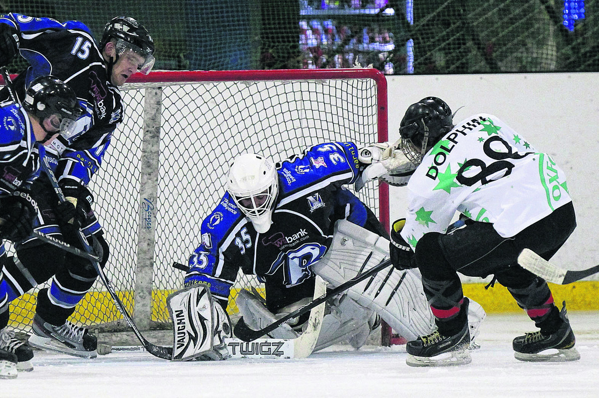 Oxford youngster Zach Dolphin gets his shot away, but Bristol netminder John Dibble is down quickly to snuff out the danger