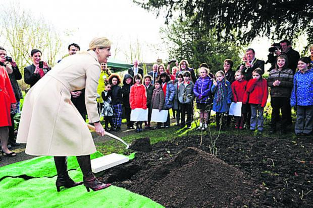 Bicester Advertiser: The Countess of Wessex at Dorchester Abbey burying the time capsule