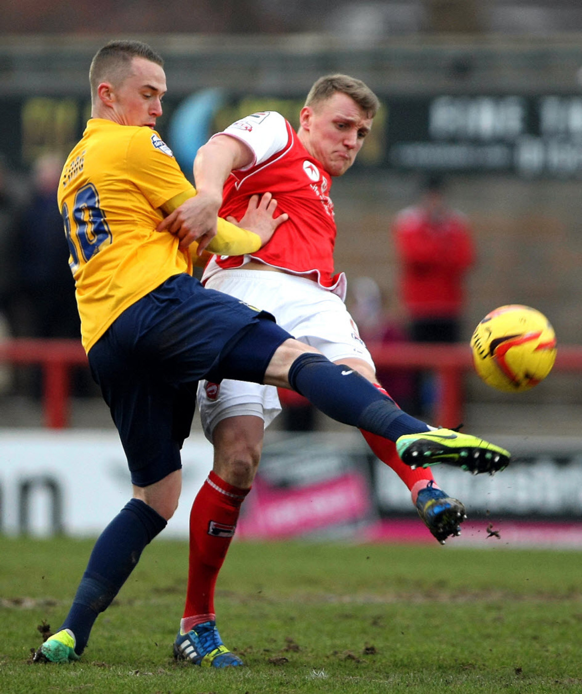 United youngster Sam Long tackles Morecambe's Jack Sampson during Saturday's 1-1 draw, but he is prepared to make way for senior players when they return from fitness