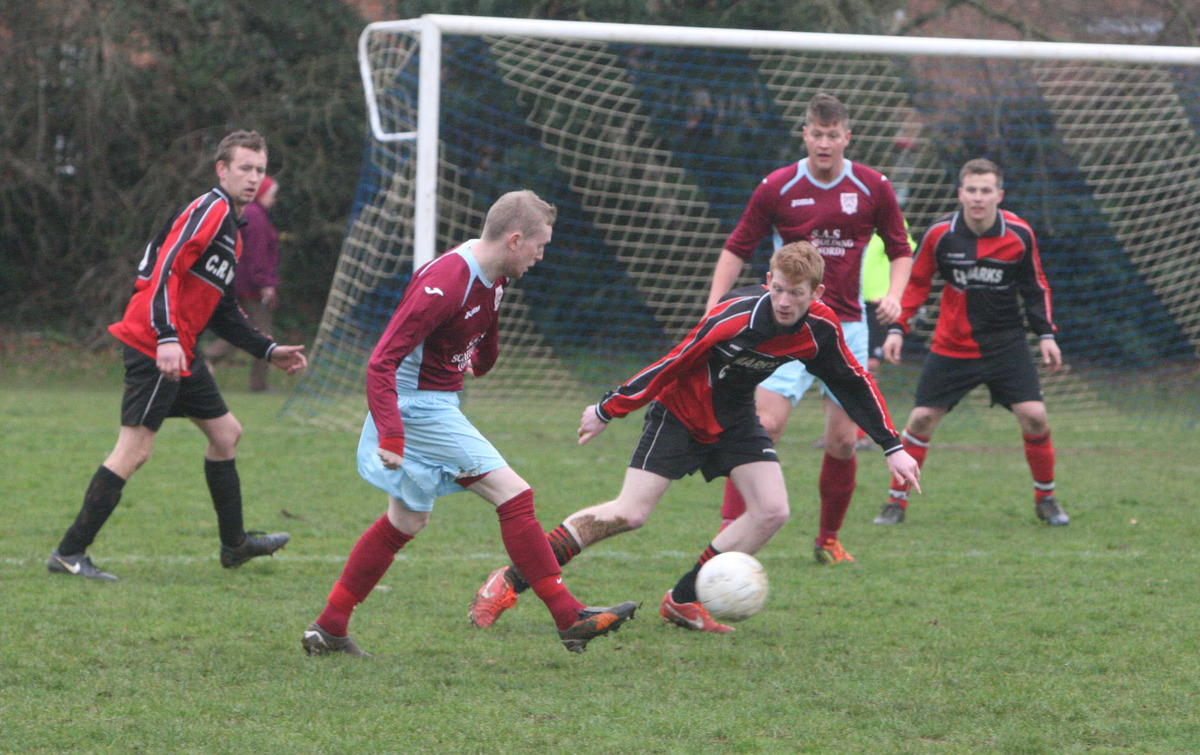 Freeland's Aston Leach fires a ball into the box during a game his side won 4-2 against Blacks Head Bletchingdon