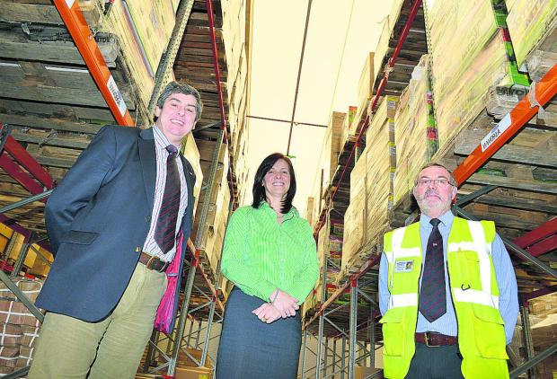 In the new £2.5m warehouse at EP Barrus in Bicester are, left to right, Robert Muir, managing director, Keryn Clarke, director of operations, and Bob Troup, warehouse manager. Picture: OX65544 Simon Williams