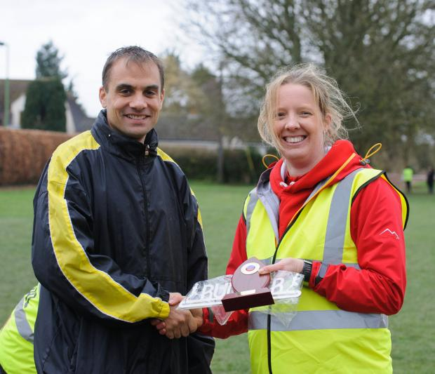 Bicester Advertiser: Paul Fernandez receives his winner's trophy from race director Ellie Barnes    Picture: Gareth Jones, Sports-alive Photography