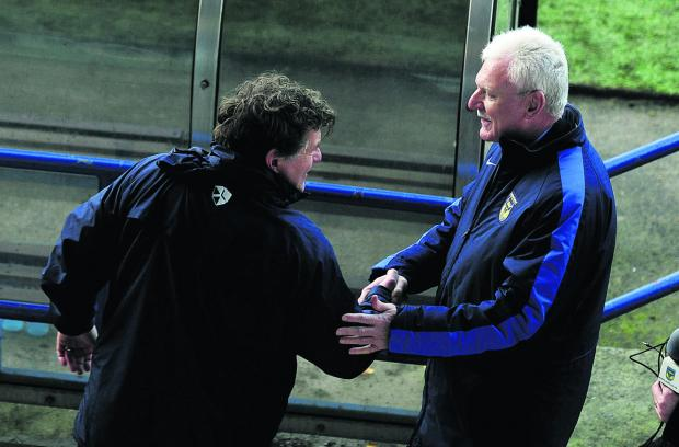 Oxford United chairman Ian Lenagan shakes hands with caretaker manager Mickey Lewis after Saturday's defeat at Rochdale