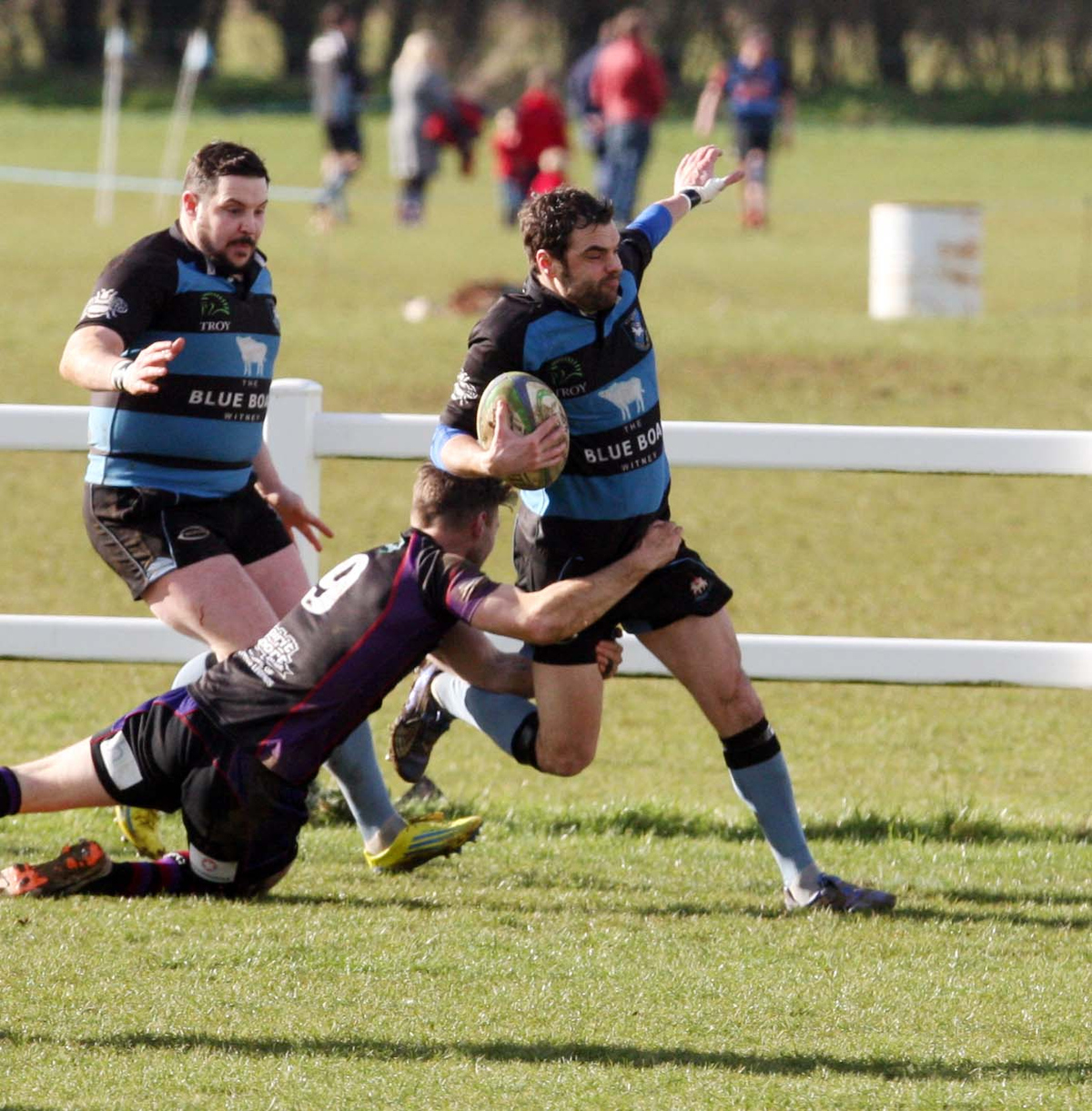 Witney full back Robbie Mills breaks through to score their opening try against Maidenhead,