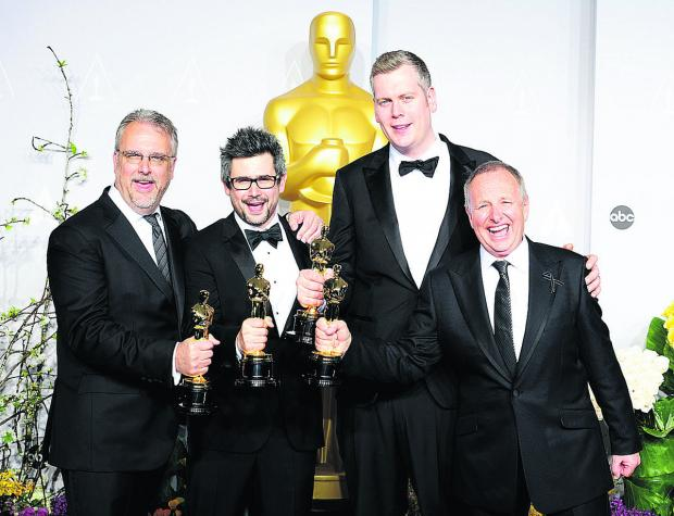 From left, Skip Lievsay, Niv Adiri, Christopher Benstead and Chris Munro with their Sound Mixing Academy Awards for Gravity