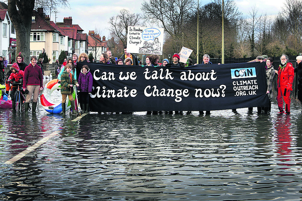 TIMELY: A flash mob raises concerns about climate change with a demonstration at flooded Abingdon Road, Oxford, last month