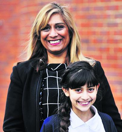 DELIGHTED: Pam Cameron and her daughter Chauni, 11, who got into first cho