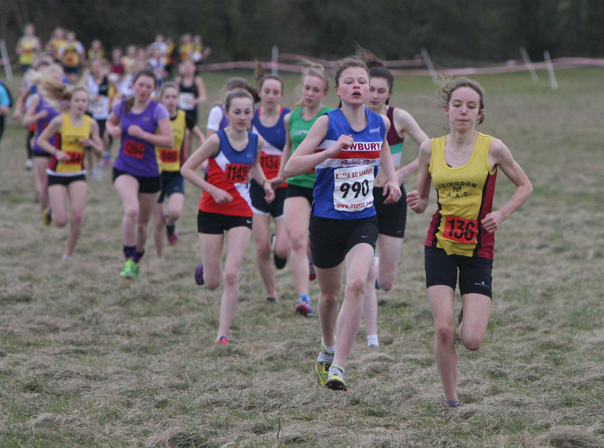Abingdon's Fiona Bunn (136) takes an early lead from Newbury's Charlotte Clover (990) at the start of the under 15/17 girls' race