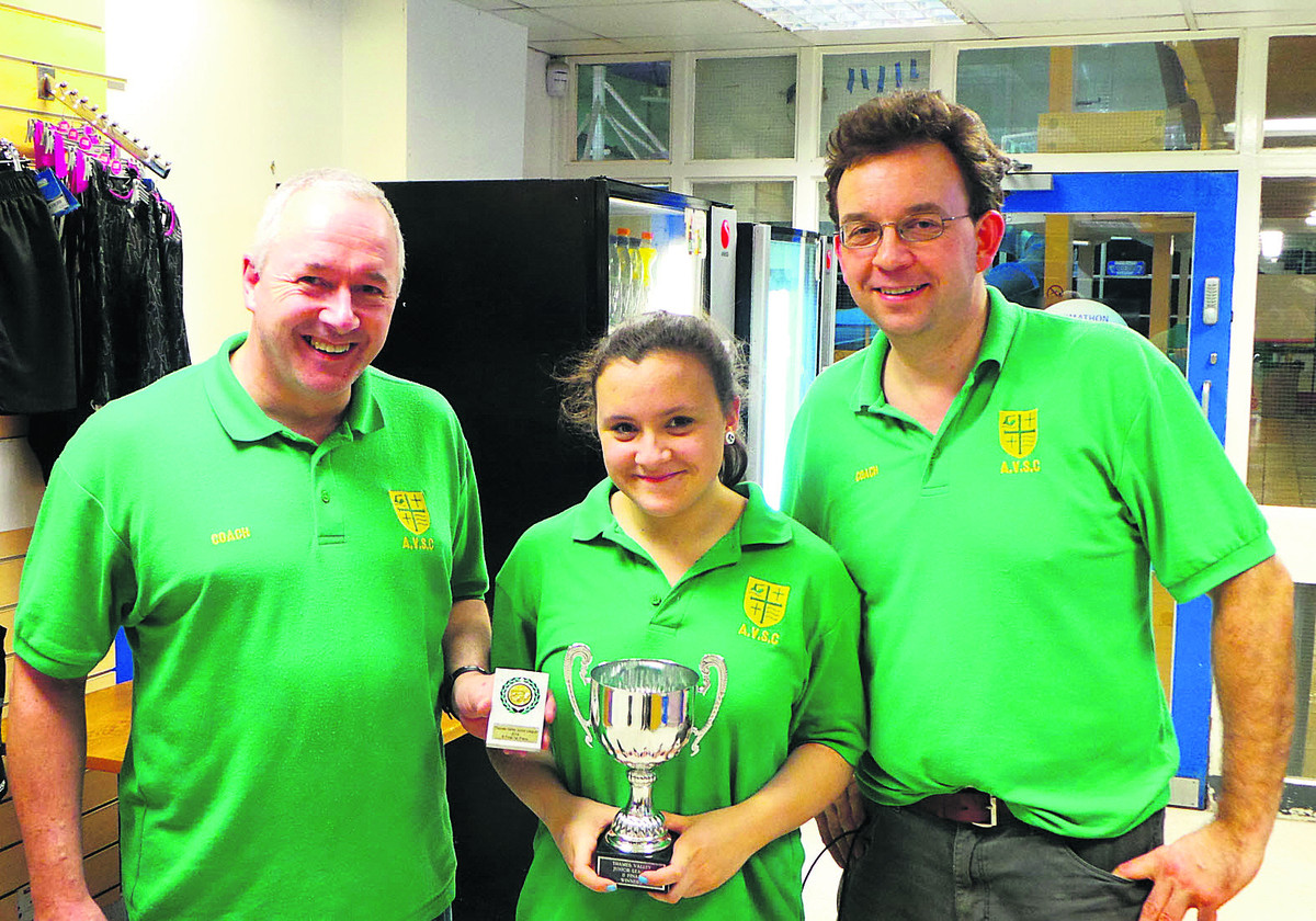 Abingdon Vale captain Caitlin Wheatley proudly holds the Thames Valley Junior League B trophy, flanked by coach Bruce Rennie (left) and manager James Halfhead