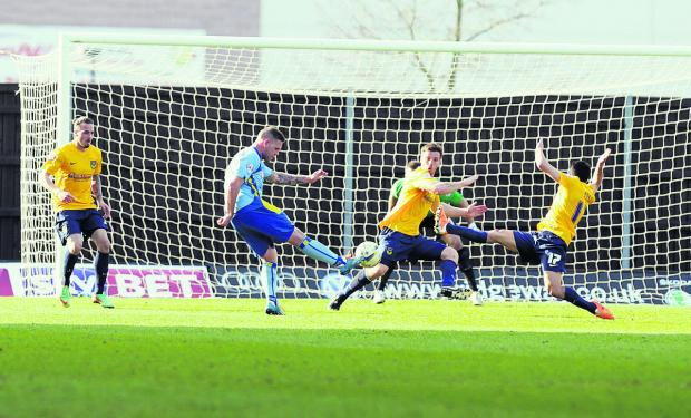 Bicester Advertiser: Johnny Mullins and Danny Rose (No 17) do their best to try and block Billy Kee's goalbound shot