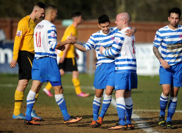 Zac McEachran (centre) is congratulated by Kayden Jackson (left) and Tom Winters after scoring Oxford City's first goal