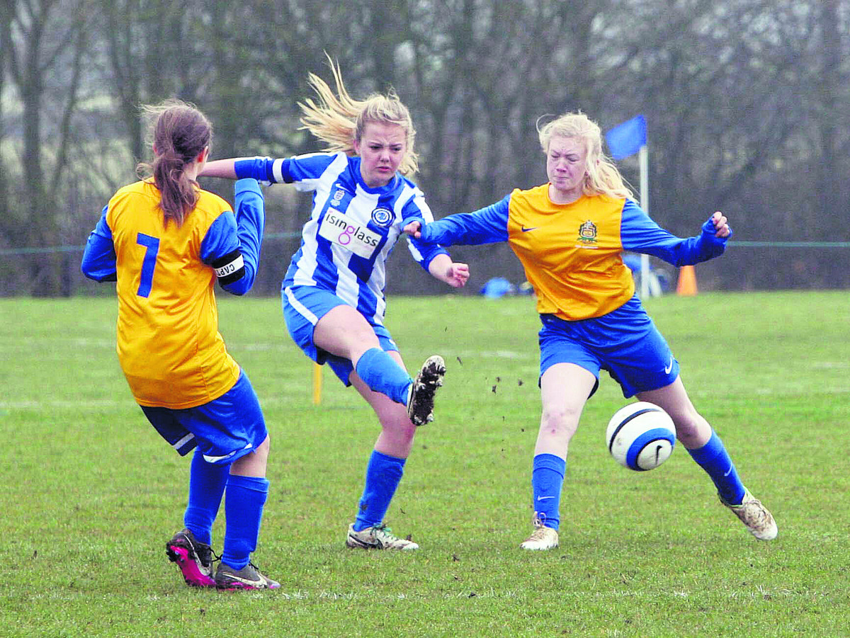 Stonesfield's Martha French fires towards goal under severe pressure from Bardwell's Gemma Williams in their Under 15 clash