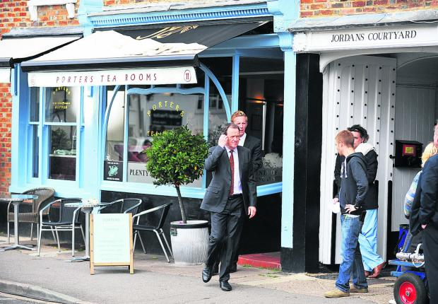 Bicester Advertiser: Kevin Whately and Laurence Fox filming a scene for Lewis in 2012 at Rumsey's Chocolaterie in Thame, which became Porters Tea Rooms for the occasion.  Picture: OX53883 Jon Lewis