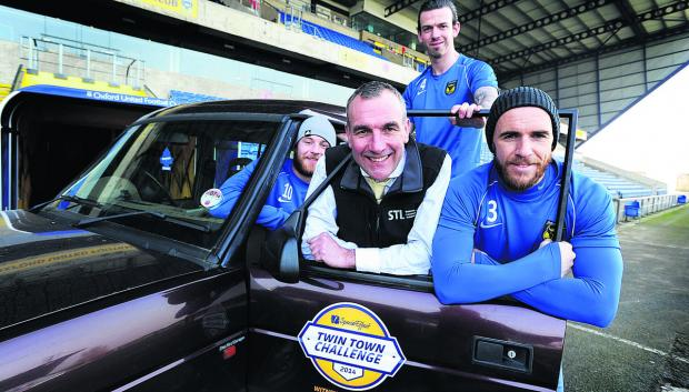 Bicester Advertiser: SpecialEffect vice president and organiser of the rally, Brendon Cross, with players, from left, Deane Smalley, Michael  Raynes and Tom Newey. Picture: OX65926 Jon Lewis