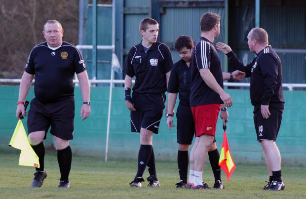 AFC Hinksey manager Kevin McMahon (right) verbally attacks referee Craig Boyles (second left) at the final whistle before being red-carded for foul and abusive language
