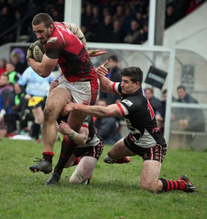 London Welsh's Karl Kirwan (left) scores one of their tries against Cornish Pirates