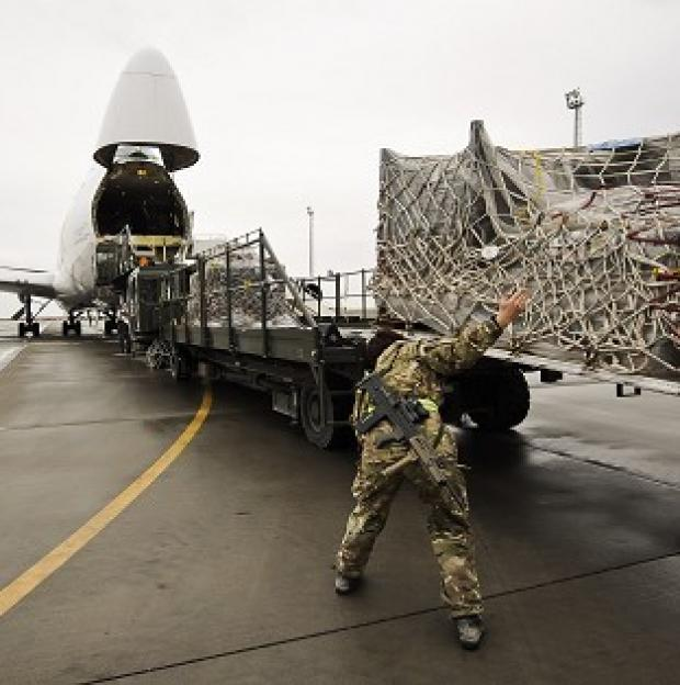 Bicester Advertiser: Equipment being loaded into a plane bound for the UK after being recovered from closed down Army bases in Helmand province, Afghanistan