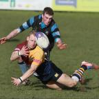 Bicester Advertiser: Oxford Harlequins' Jack Robinson gets his pass away as Witney's Carl Campbell closes in