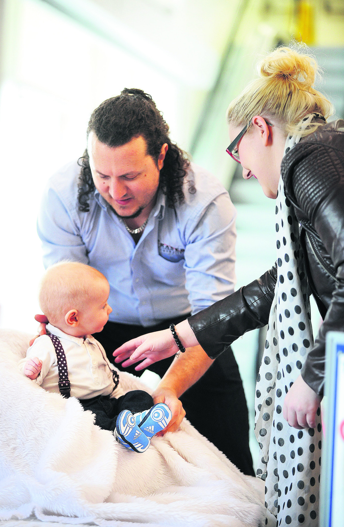 Photographer Ross Jennings, left, of Fraser Portraits, organises Alfie Cassels with his mother Kate