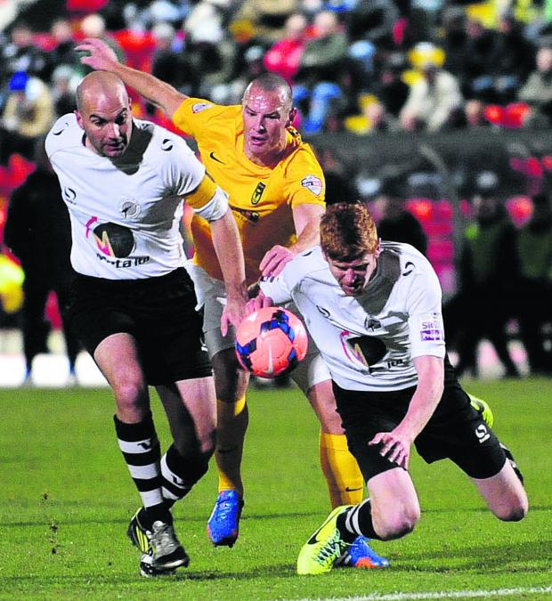 Bicester Advertiser: James Constable takes on two Gateshead defenders during the tough 1-0 win in the FA Cup earlier this season