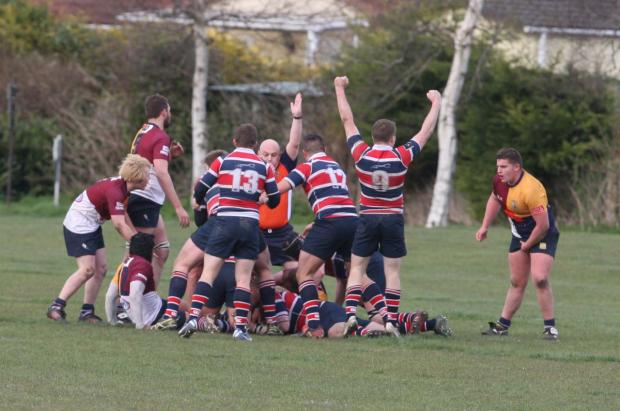 Bicester Advertiser: Grove celebrate their penultimate try against Oxford Harlequins from Jimmy Wallbridge, who is buried in the middle