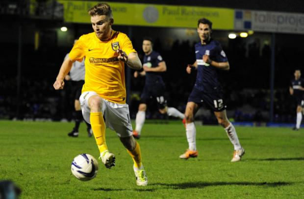 Oxford United's Alfie Potter sets off on a run