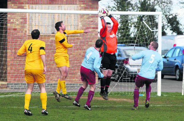 Bletchingdon keeper Nick Lacey takes a cross in the win over Mansfield Road. He saved two penalties as they won 4-2 on spot-kicks
