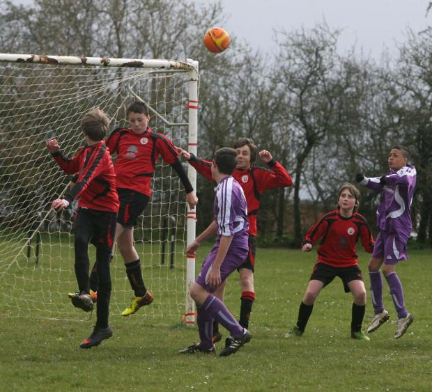 Faringdon's Tom Lawrence wins this tussle in the game with Botley