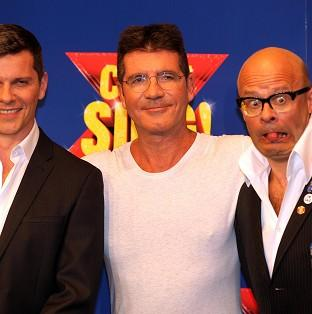 Bicester Advertiser: Nigel Harman (left) will play Simon Cowell (centre) in the musical penned by Harry Hill (right).
