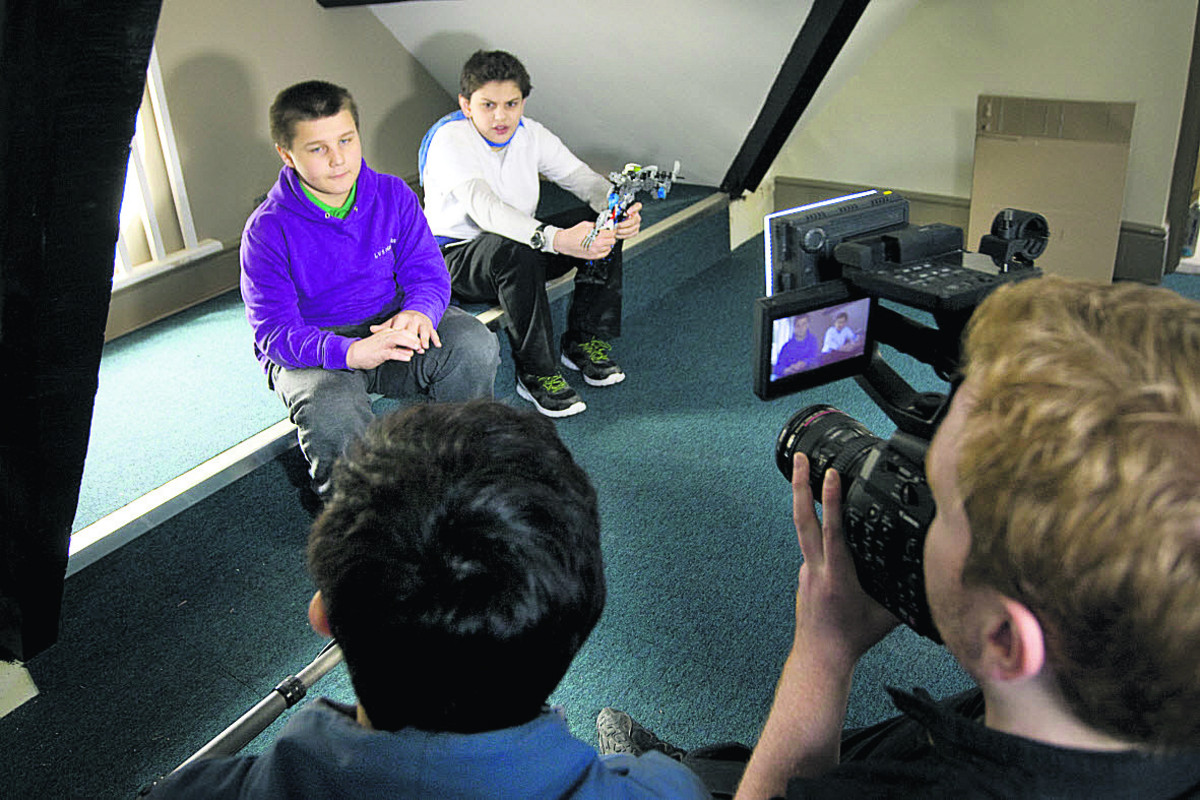 Pupils Rees Groombridge and, right, Asa Barakzai, who attend the Hassocks school for autistic children in West Sussex, are filmed for a promotional video about the new school near Oxford		       Picture: OX66116 Antony Moore
