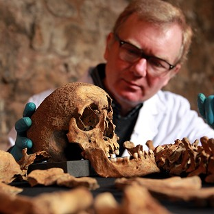 Osteologist Don Walker with some of the skeletons that were discovered last year by Crossrail during construction works in Charterhouse Square