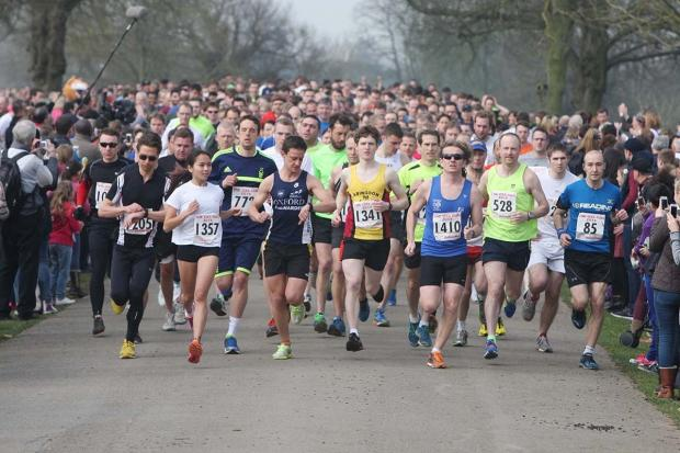 Bicester Advertiser: RECORD-BREAKER: Hundreds of runners set off at the start of the OX5 run