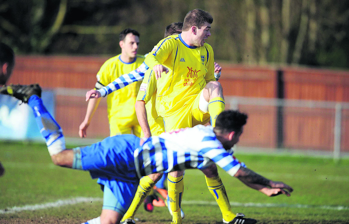 Darren Pond heads in Oxford City's late equaliser in the 3-3 draw with Guiseley