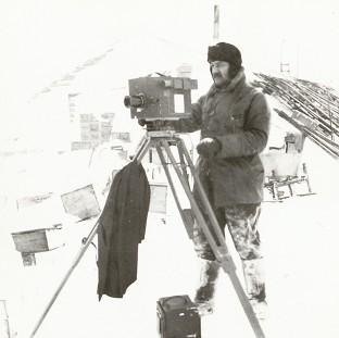 Bicester Advertiser: Herbert Ponting working in Antarctic conditions in a picture taken by polar explorer Captain Scott in October 1911 (Scott Polar Research Institute)