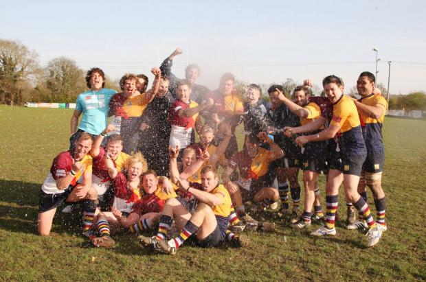 Bicester Advertiser: Oxford Harlequins crack open the champagne to celebrate winning the South West 1 East title