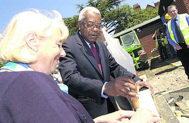 2002: Sir Trevor McDonald and Valerie Bell lay the foundation stone of Douglas House
