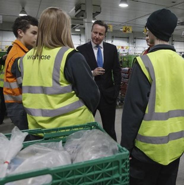 Bicester Advertiser: Prime Minister David Cameron speaking to apprentices at a Waitrose food distribution centre