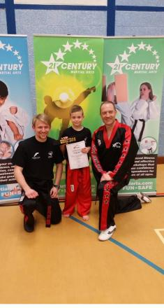Callum Beattie is pictured with chief instructor Eliott Manning (left) and school founder Phil Hatton